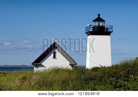 Long Point lighthouse on a warm summer day on the tip of Cape Cod.