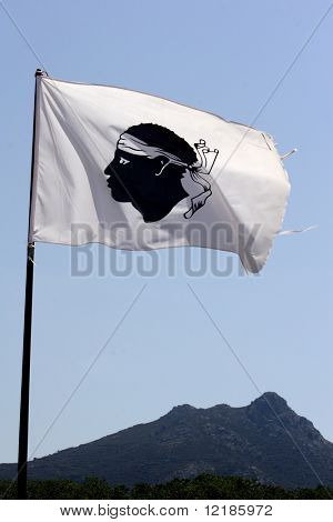 Corsica flag with mountains in background, Corsica, France