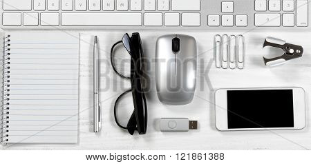 White Desktop With Office Supplies Under Computer Keyboard