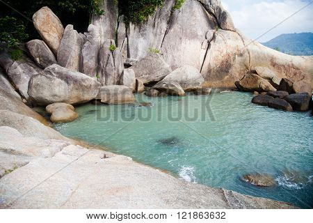 large rocks washed by the ocean