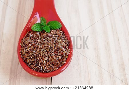 Brown flaxseeds. Healthy food supplement with vitamins and minerals.