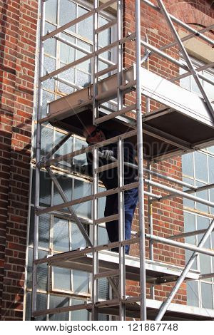 A painter and decorator working from a scaffold tower ** Note: Soft Focus at 100%, best at smaller sizes