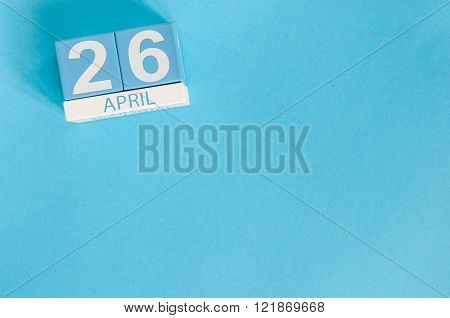 April 26th. Image of april 26 wooden color calendar on blue background.  Spring day, empty space for
