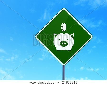 Money concept: Money Box With Coin on road sign background