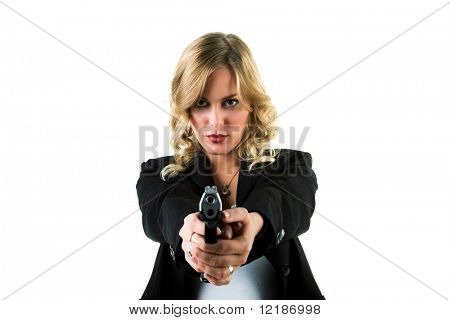 A blond girl in a suit with a handgun