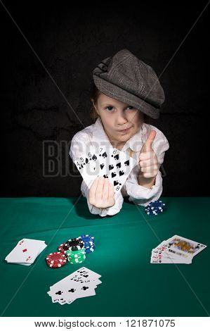 Child with the winning combination of poker
