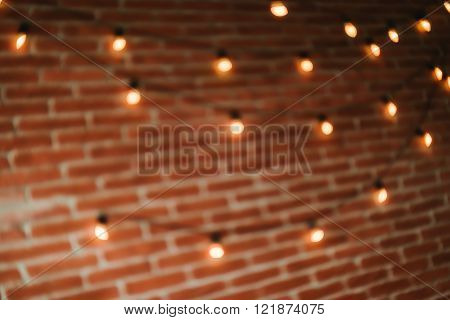 edison light bulbs against brick wall background