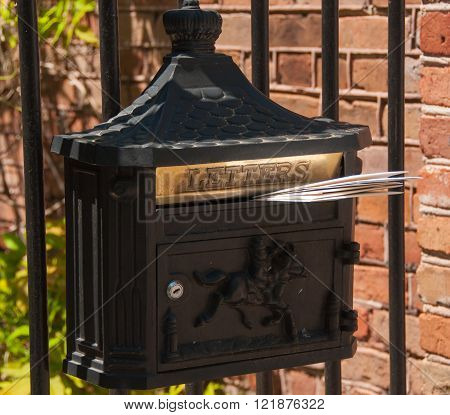 A photograph of a mailbox a type that is seldom seen in a South Carolina historical district.