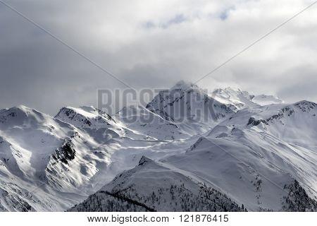 Evening sunlight mountains in haze. Caucasus Mountains. Svaneti region of Georgia.