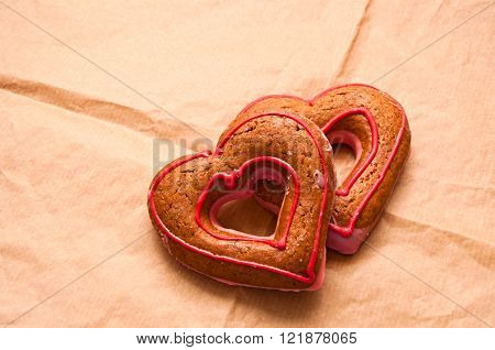 honey-cakes in shape of heart on paper