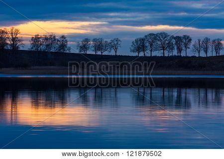 Beautiful lake landscape after sunset. Daybreak landscape of lake in Mazury lake district