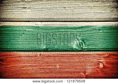 Flag of Bulgaria painted on old grungy wooden background