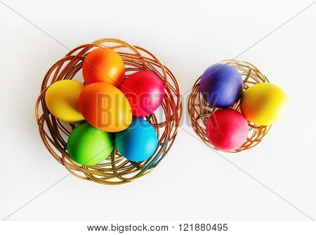 Bright multi-colored easter eggs in two baskets. Colorful easter eggs. Top view.