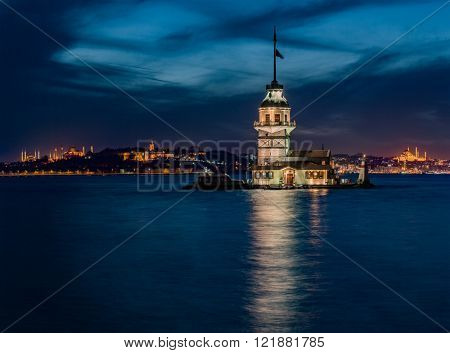 Maiden's Tower and The Old Town  with Topkapi Palace and Mosques at night in Istanbul Turkey