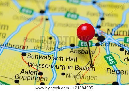 Photo of pinned Weissenburg in Bayern on a map of Germany. May be used as illustration for traveling theme.