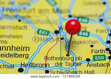 Photo of pinned Rothenburg ob der Tauber on a map of Germany. May be used as illustration for traveling theme.