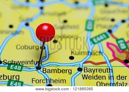 Photo of pinned Bamberg on a map of Germany. May be used as illustration for traveling theme.