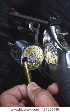 Man Loading Magnum Revolver Detail Closeup Gun