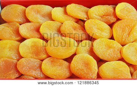 Traditional dried fruit. Dried apricot. On the wood bacgraund.