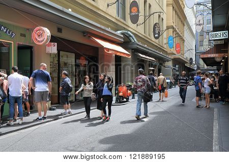 MELBOURNE AUSTRALIA - MARCH 13, 2016: Unidentified people walk Melbourne café street in downtown Melbourne.