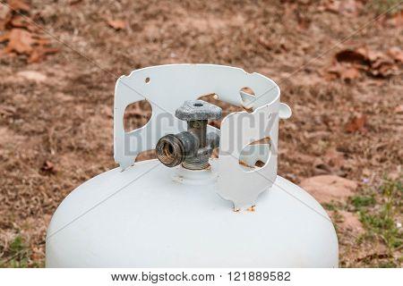 Valve on a propane tank shot out side.