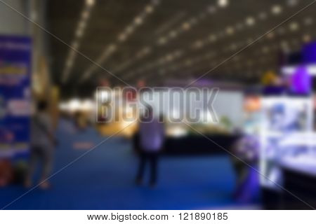 blur background of people shopping in fair tradeshow which retailer selling various product