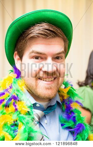 A man in business attire partakes in St Pattrick's day festivities.