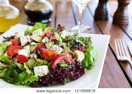 Mediterranean salad with tomatoes, olives and peppers