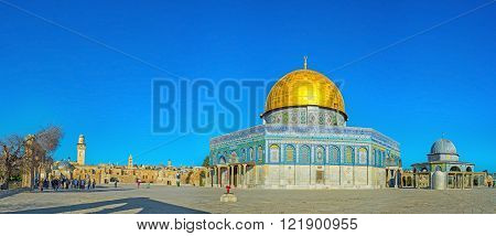 JERUSALEM ISRAEL - FEBRUARY 16 2016: The Dome of the Rock decorated with islamic patterns of the colorful glazed tiles and topped by the large golden cupola on February 16 in Jerusalem.