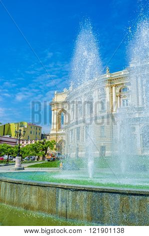 ODESSA, UKRAINE - MAY 18, 2015: The view through the fountain on the Opera Theatre of Odessa, on May 18 in Odessa.