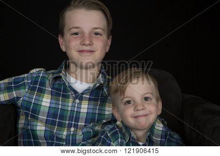 Brothers portrait matching shirts smiling at camera