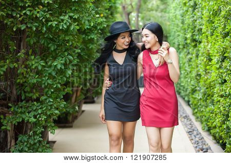 Best Friends Taking A Walk Together In Outdoor Park. Friendship And Fun Time Concept