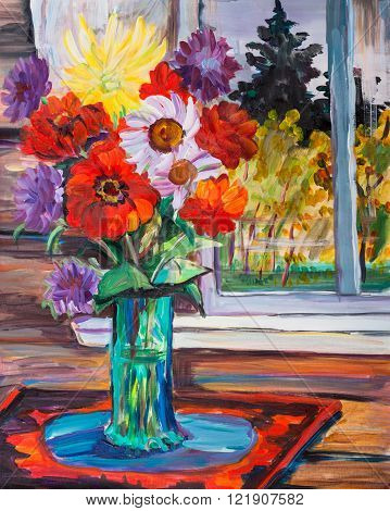 Bouquet of autumn flowers in glass vase
