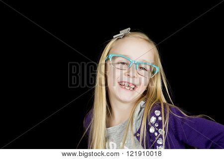 Cute blond girl with blue glasses big smile missing tooth