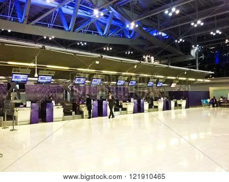 BANGKOK - FEBRUARY 17 : People waiting in check-in line R terminal of the Bangkok airport on February 17 2016. Suvarnabhumi airport is world's 4th largest single-building airport terminal.