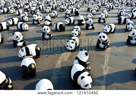 BANGKOKTHAILAND - MARCH 4 2016 : 1600 Pandas+ TH Paper mache Pandas to represent 1600 Pandas and to raise awareness in conservation and sustainable development for endangered animals in Thailand.