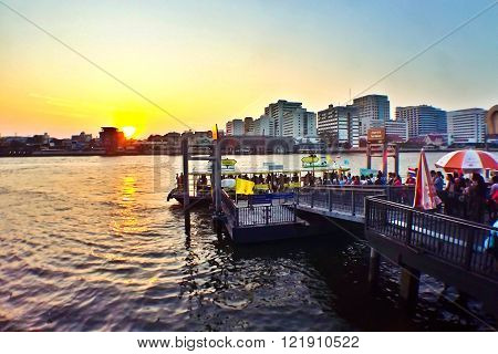 BANGKOKTHAILAND - MARCH 4 2016: A pier for traveling along Chao Phraya River on regular city boat line which serves over 50000 passengers daily Bangkok Thailand