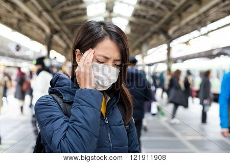 Woman feeling unwell in train station