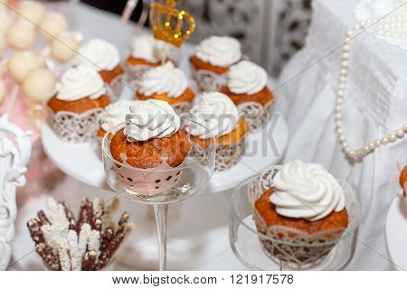 muffins cakes delicacies on a festive table in restaurant