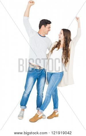 Triumphant couple raising fist on white background