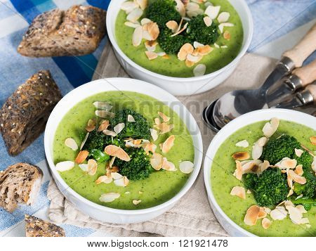 Broccoli soup in bowls for lunch with whole grain bread