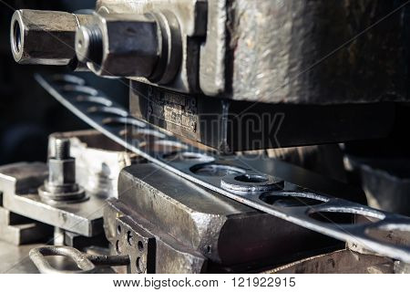 High precision sheet metal stamping and punching machinery. Old punching machine closeup.