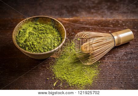 Powder green tea with whisk matcha, studio shot