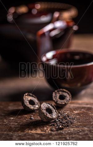 Dry pressed pu-erh tea leaves briquettes, studio shot