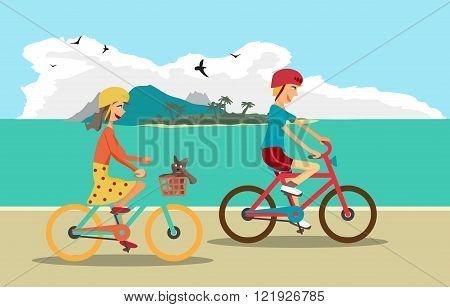 Girl and boy ride the bike on the beach. Healthy leisure and fre