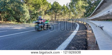 Blurred motorbike on curve