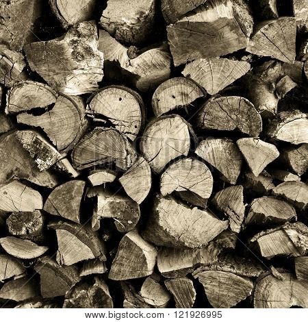 Stack of chopped and split firewood logs arranged.