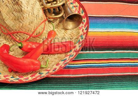 Mexico Poncho sombrero Background copy space edge with chili and trumpet