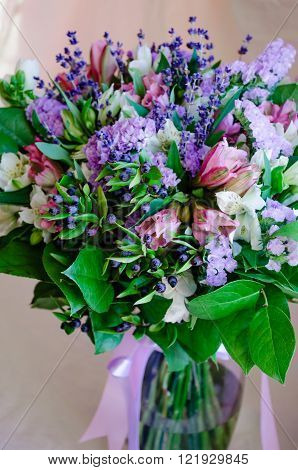 Beautiful romantic spring bouquet of flowers in a vase  pink violet lavander