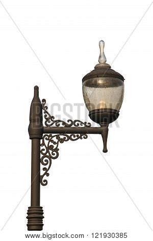 Old and weathered lamp post with isolate background
